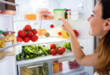 Woman looking in fridge (iStock/PA)