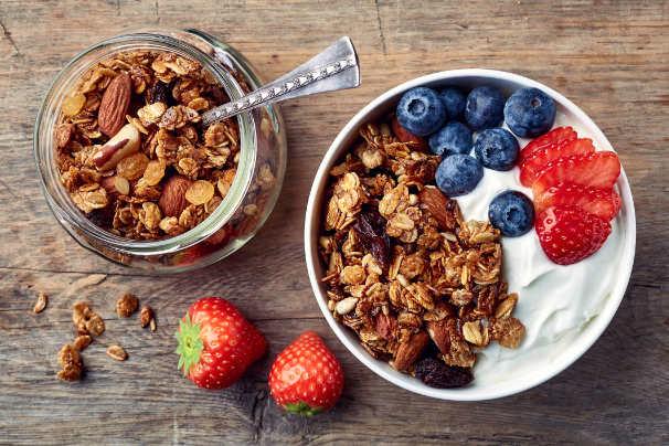 Bowl of homemade granola with yogurt and fresh berries
