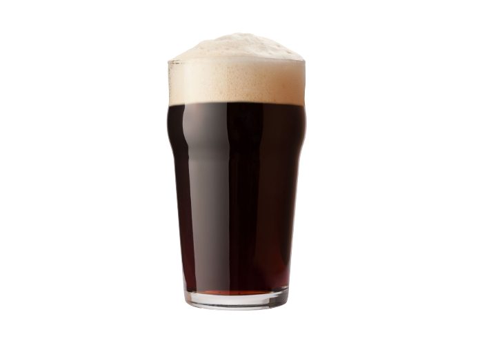 Glass of English Stout beer with a frothy foam head.