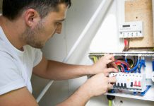 Rewiring your home Electrician wiring a new circuit breaker for a residential property