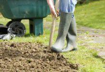Best soil enrichers A portrait of a caucasian gardener forking a patch in the garden.