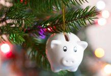 top ten money saving tips for ChristmasPiggy bank ornament on Christmas tree