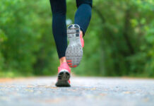 What happens to your body during exercise? Running woman in the forest.