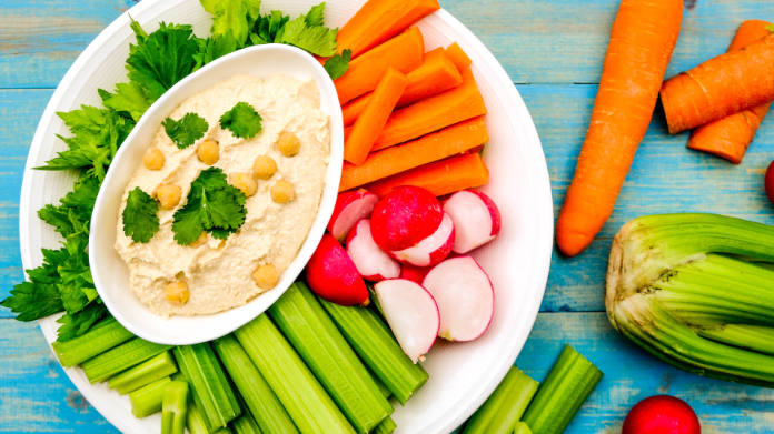 Mediterranean Hummus With Fresh Vegetables Including Carrots, Celery and Radishes Crudites