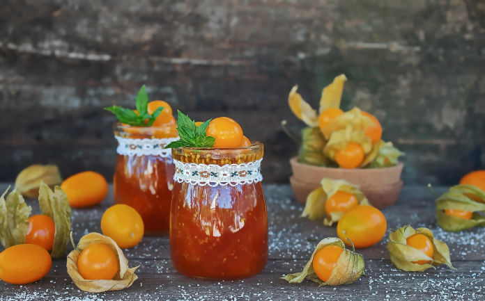 jam of physalis and orange on an old wooden table