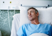 Cancer symptoms to be aware of Shot of a sick man lying in a hospital bed