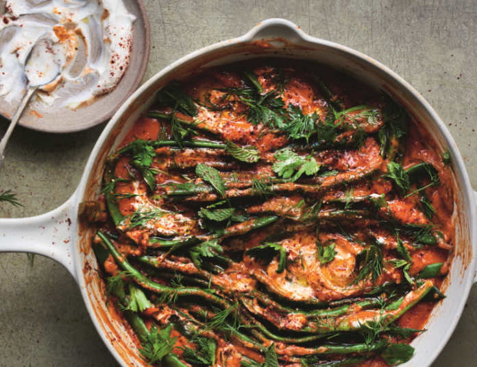 Braised flat beans in slow cooked tomato sauce from Restore by Gizzi Erskine (HQ/Issy Croker/PA)