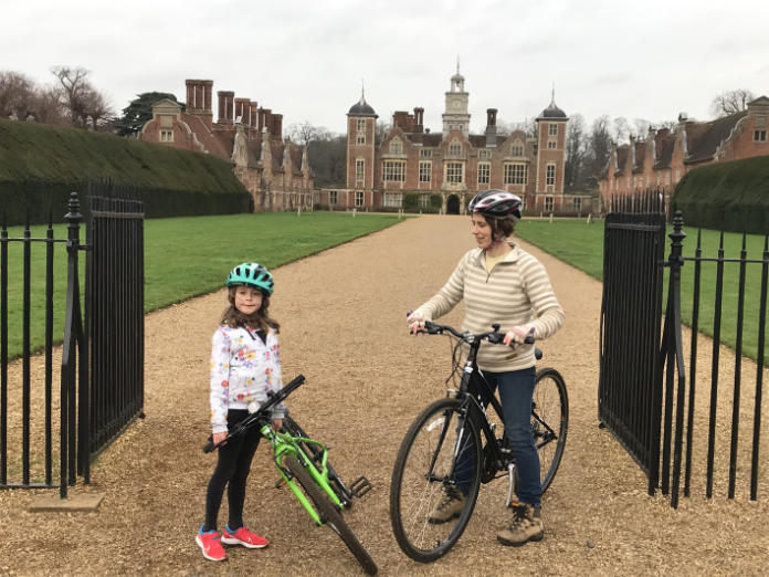 Norfolk family holidays - Noreen and Eve on bikes in front of Blickling Hall