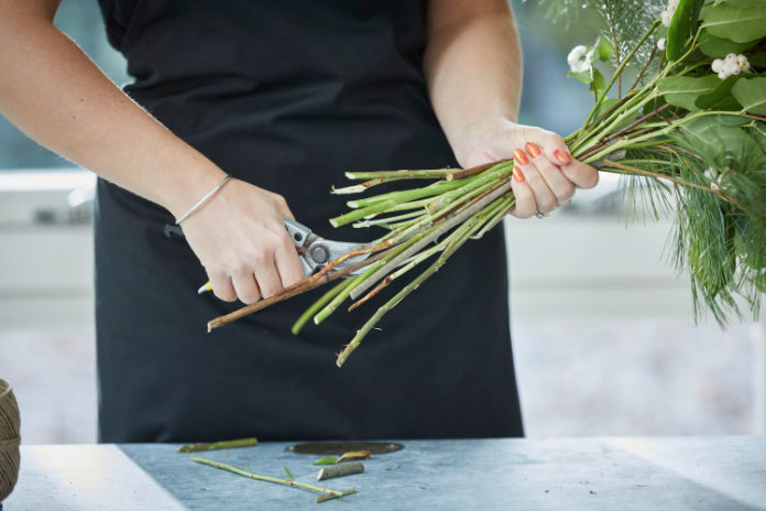 Cut stems of a rose bouquet