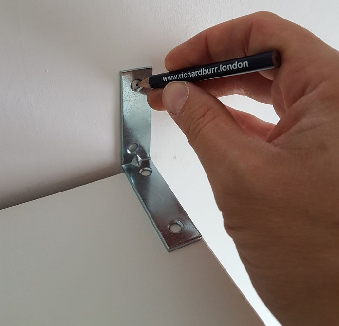 how to secure furniture to a wall