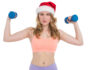 Festive fit blonde holding dumbbells on white background