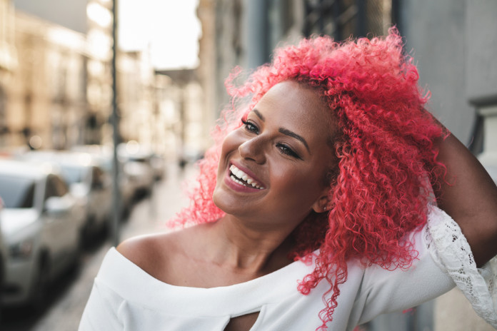 Woman with pink afro hair