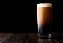 Stout beer on wooden surface