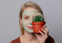 Cactus beauty products beautiful blond girl with green mask and cactus