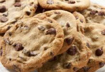 A plate of freshly baked chunky chocolate chip cookies.