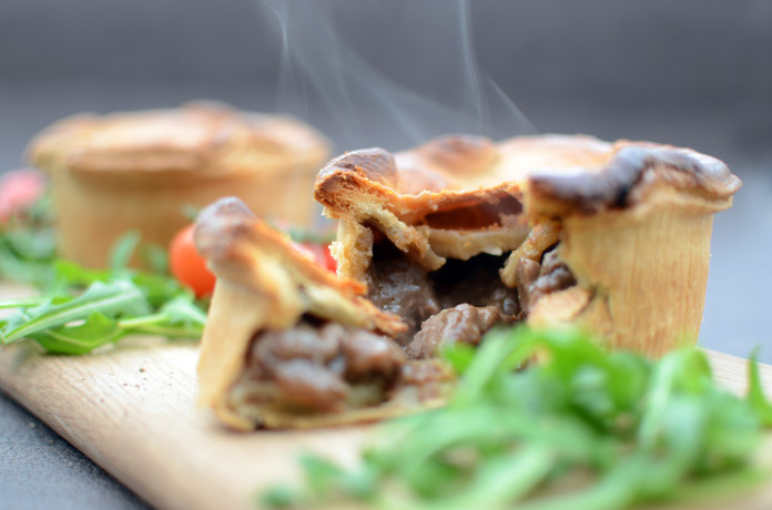 A home-made steak and ale meat pie using hot water crust