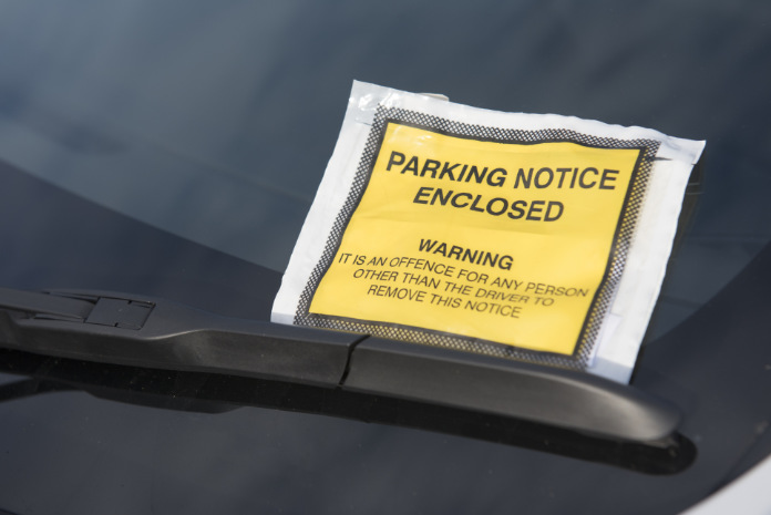 Close up image of a parking ticket on a car windscreen