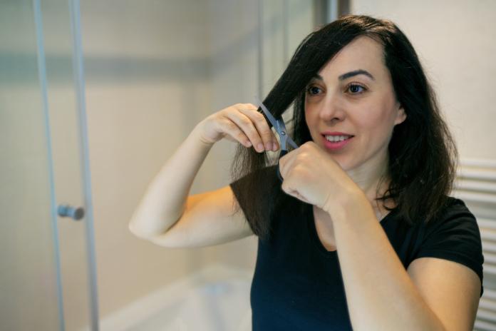 Woman cuts her own hair