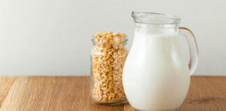 Pea milk Vegetable pea milk in a milk jug and peas in a jar