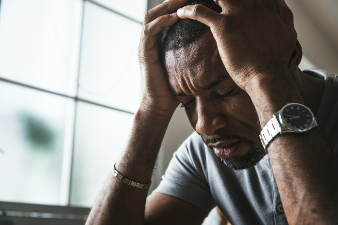 Black guy suffering hair loss caused by stress