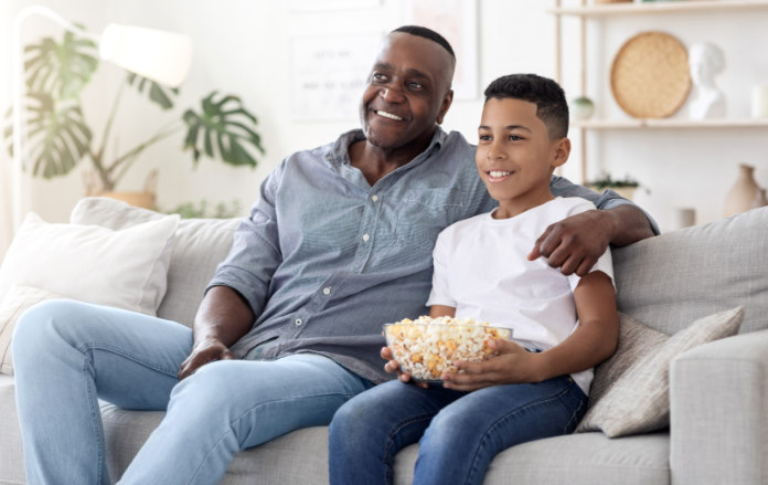 Happy Black Senior Man Spending Time With His Grandson At Home,
