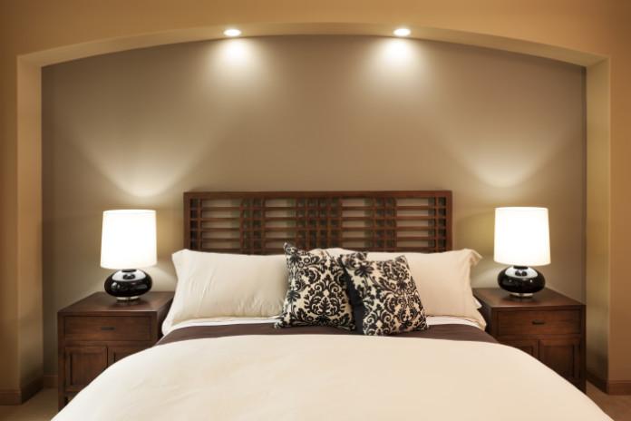 Elegant master bedroom scene in a custom home.