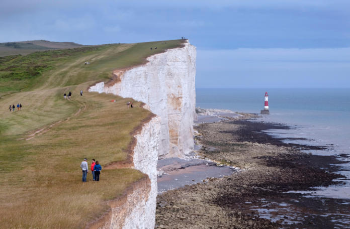 People on the South Downs Way footpath near Beachy Head. Eastbourne, Sussex, England.