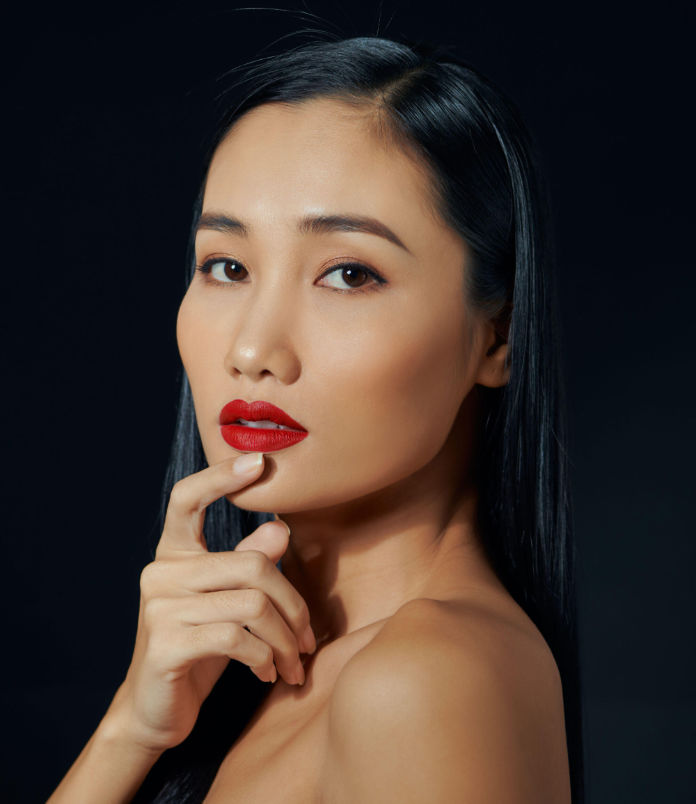 A Generic Photo of Asian woman wearing red lipstick.