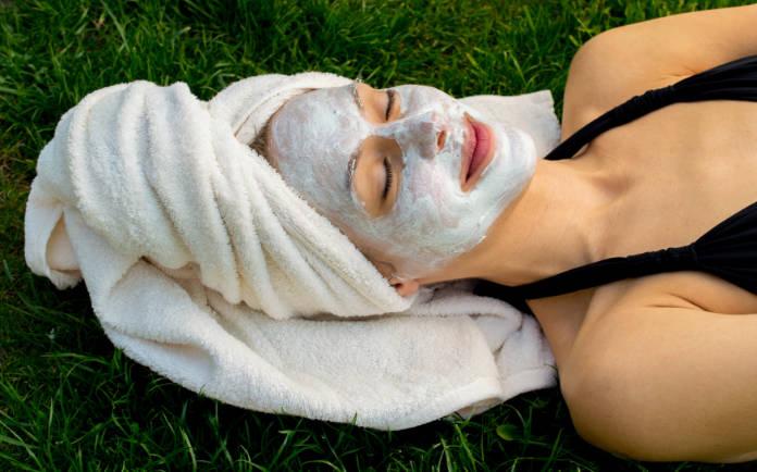 Woman having facial mask in garden