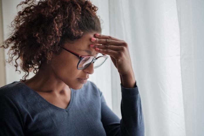 women in pain suffering from a serious headache