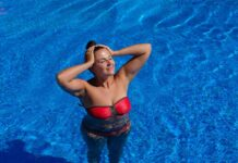 Women with a tan in a pool