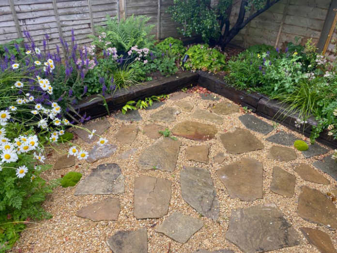 Old paving slabs showing a great garden design idea