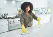 A lady clearing her home of any health hazards
