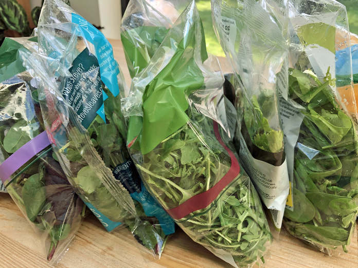 Multiple bags of salad leaves