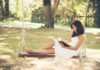 Women in swing chair looking at best summer reads