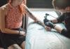A tattoo artist creating a tattoo
