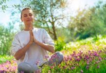 Lady experiencing wellbeing in her garden