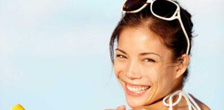 does suncream go off? A women putting on suncream