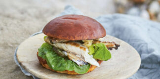 Fried mackerel, with horseradish butter, gherkins and lettuce in brioche buns