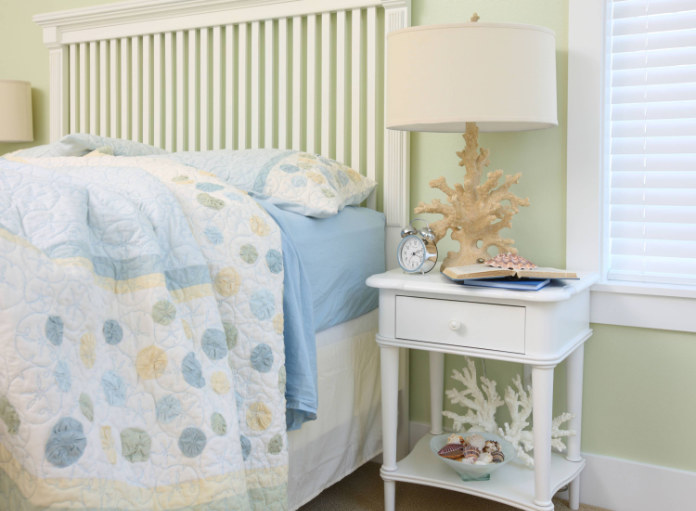 Using a lighter colour palette, an example of  small bedroom ideas
