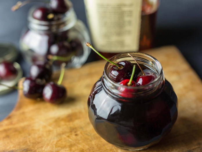 A jar of pickled cherries
