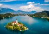 A small island with a house and tall tower in Slovenia