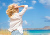 A women standing in the coast, How to get rid of hyperpigmentation and other common summer skin problems