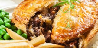 Food cravings for Homemade beef stew pie with french fries. Meat in puff pastry