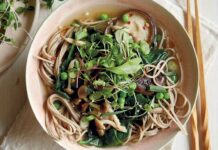 Miso noodle soup with mushrooms, peas and greens