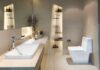 Installing a new bathroom – Modern interior of twin bathroom with sinks and toilet at home.