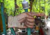 Hand sign pointing the way to antiques and secondhand items
